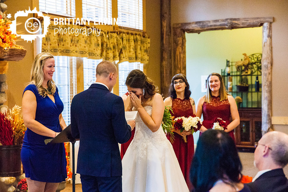 Purgatory-Golf-Club-bride-reaction-to-groom-reading-own-vows-ceremony-wedding-photographer.jpg