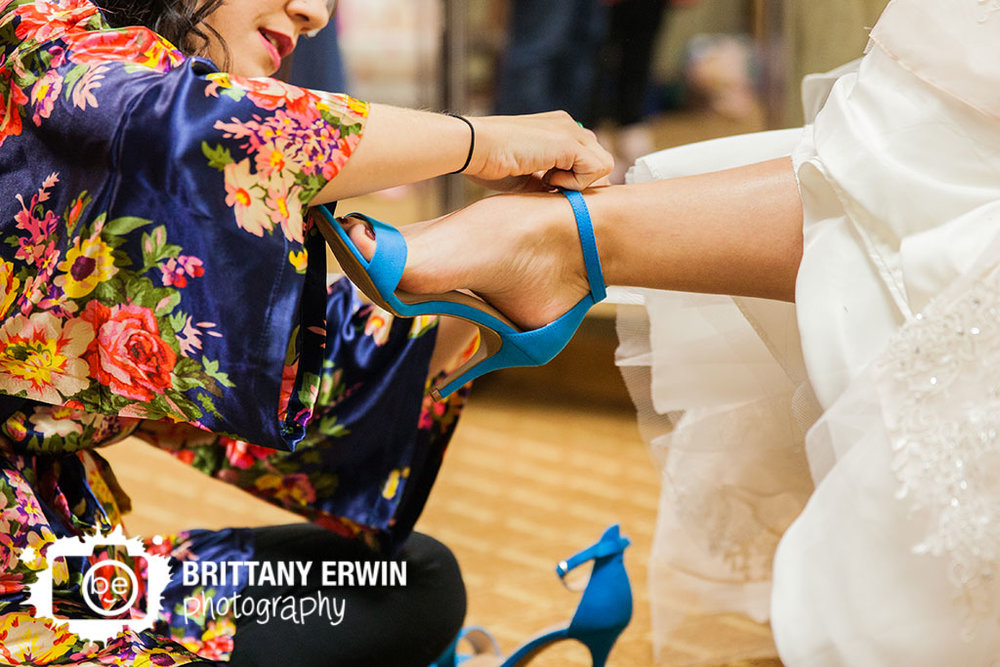 Purgatory-Golf-Club-wedding-photographer-bride-blue-shoes-getting-ready.jpg