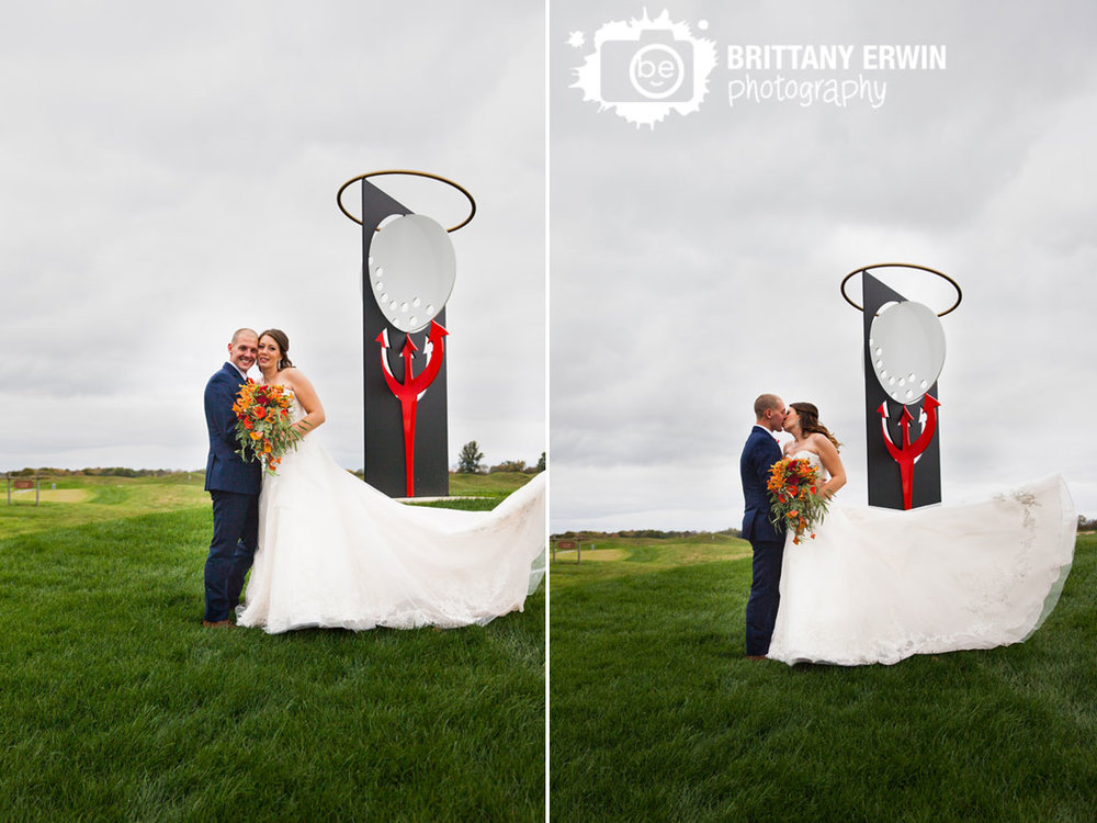 Purgatory-Golf-Club-wedding-photographer-couple-with-sculpture-ball-with-halo-on-pitchfork.jpg