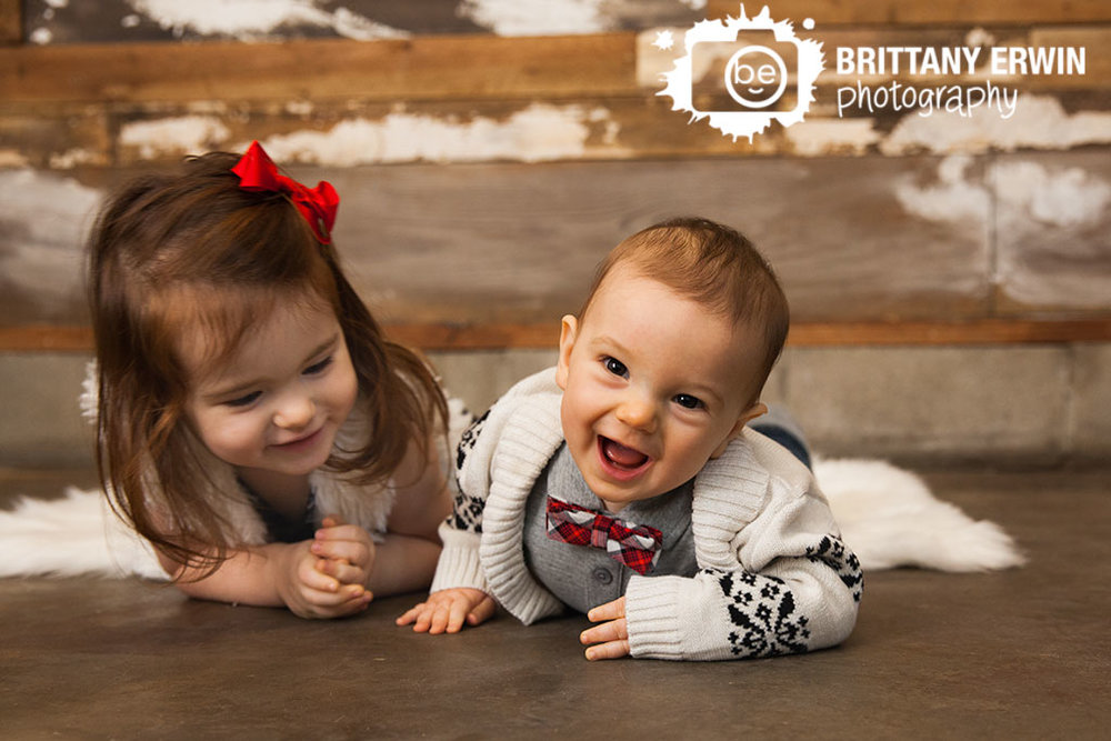 Laughing-baby-boy-with-sister-red-bowtie-family-studio-portrait-photographer.jpg