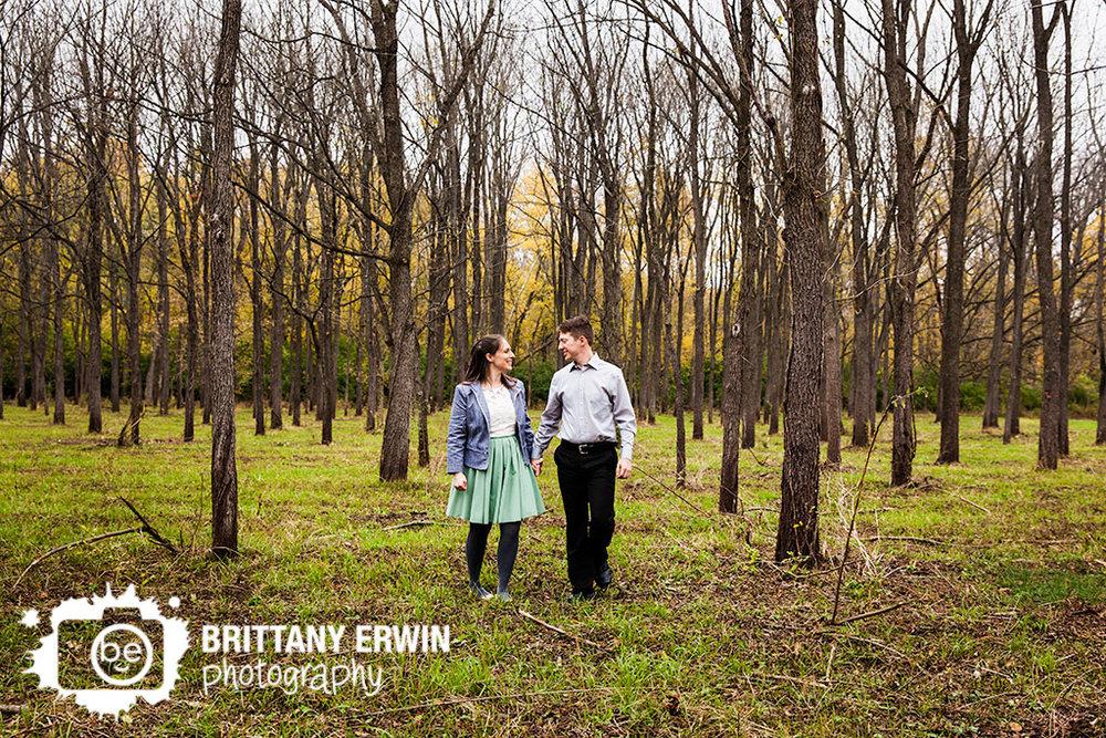 Fort-Harrison-engagement-portrait-photographer-couple-walk-walnut-trees.jpg