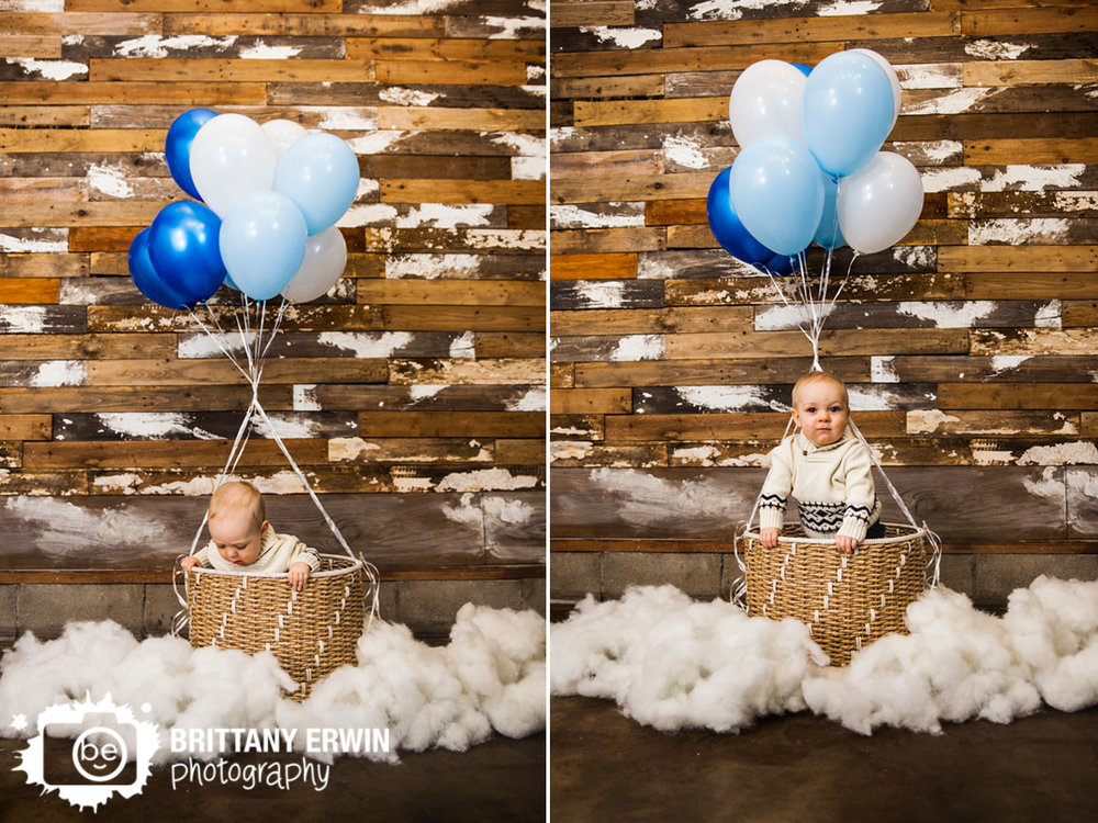 Hot-air-balloon-first-birthday-rustic-wood-wall-baby-boy-Indianapolis-photographer.jpg