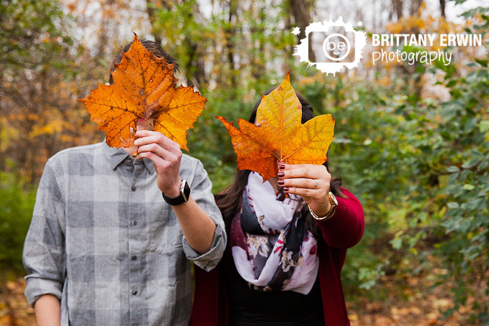 Indianapolis-fall-engagement-portrait-maple-tree-leaf-ring-couple.jpg
