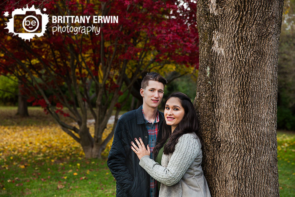 Indianapolis-fall-engagement-portrait-photographer-couple-red-maple-tree-leaves.jpg