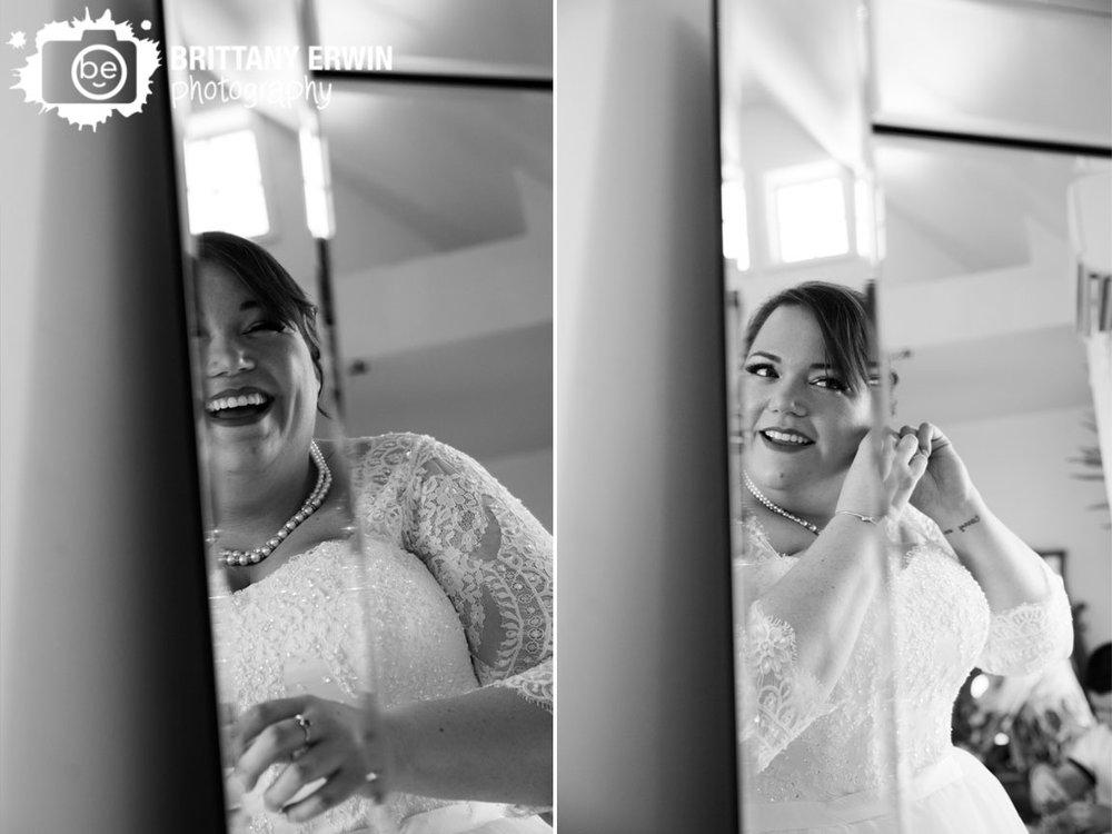 Barn-at-Kennedy-Farm-bride-getting-ready-laugh-mirror.jpg