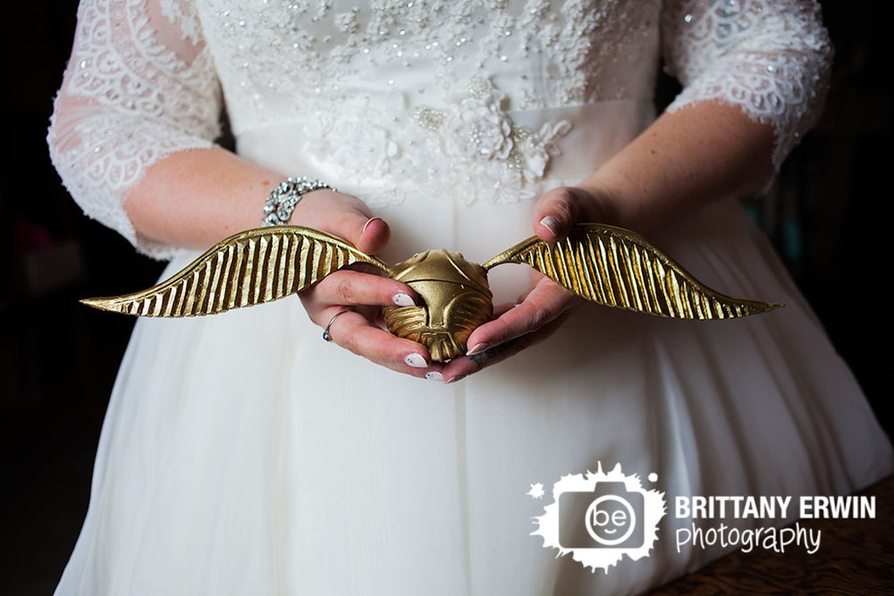 Barn-at-Kennedy-Farm-golden-snitch-ring-box-detail-photo-bride-holding-quiddich-wedding-photographer.jpg