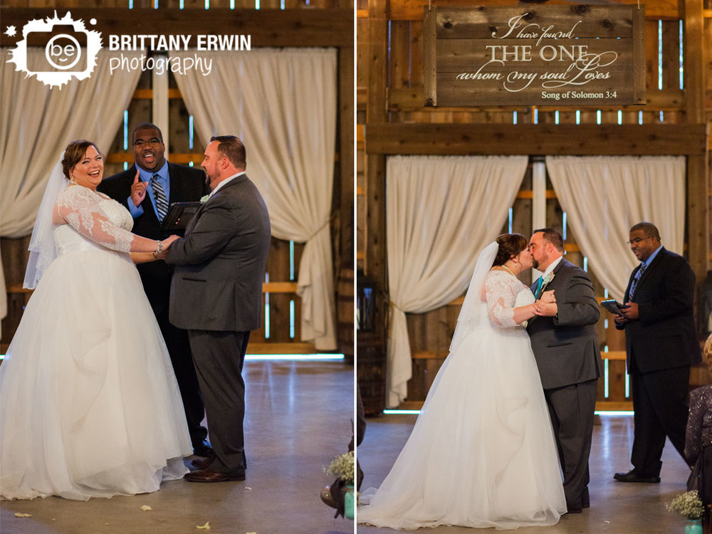 Barn-at-Kennedy-Farm-wedding-ceremony-photographer-first-kiss-bride-and-groom-indoor.jpg