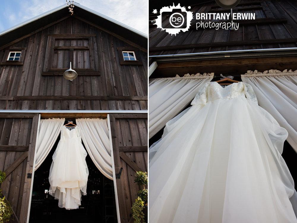 Barn-at-Kennedy-Farm-wedding-dress-detail-hanging-in-doorway.jpg
