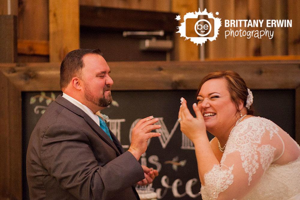 Barn-at-Kennedy-Farm-wedding-photographer-bride-groom-cut-cake.jpg