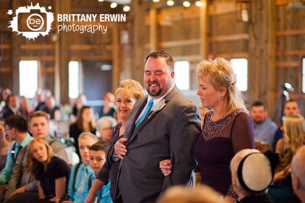 Barn-at-Kennedy-Farm-wedding-photographer-ceremony-groom-down-aisle.jpg