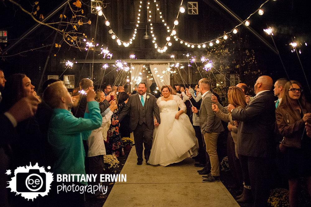 Barn-at-Kennedy-Farm-wedding-photographer-couple-sparkler-exit.jpg