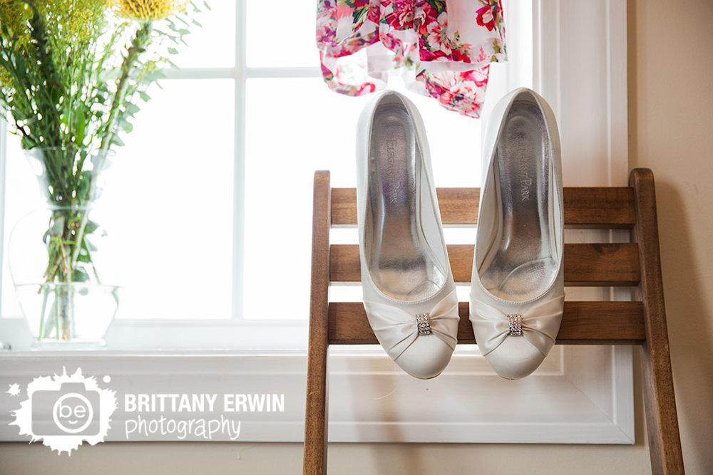 Barn-at-Kennedy-Farm-wedding-photographer-shoes-robe-flowers-in-window-on-wooden-chair.jpg
