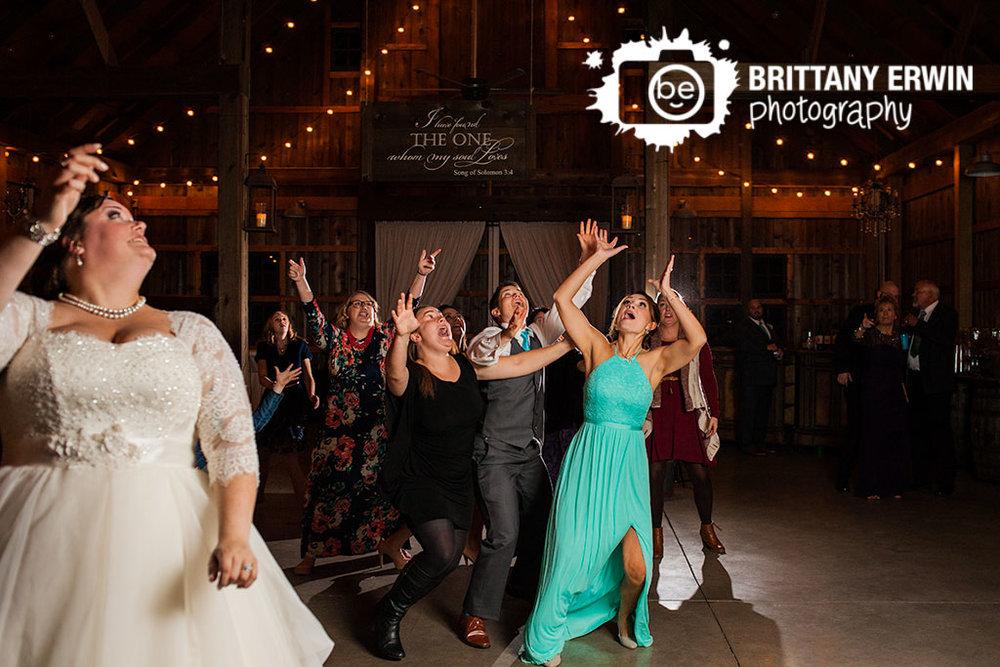 Barn-at-Kennedy-Farm-wedding-photography-bride-toss-bouquet-catch.jpg