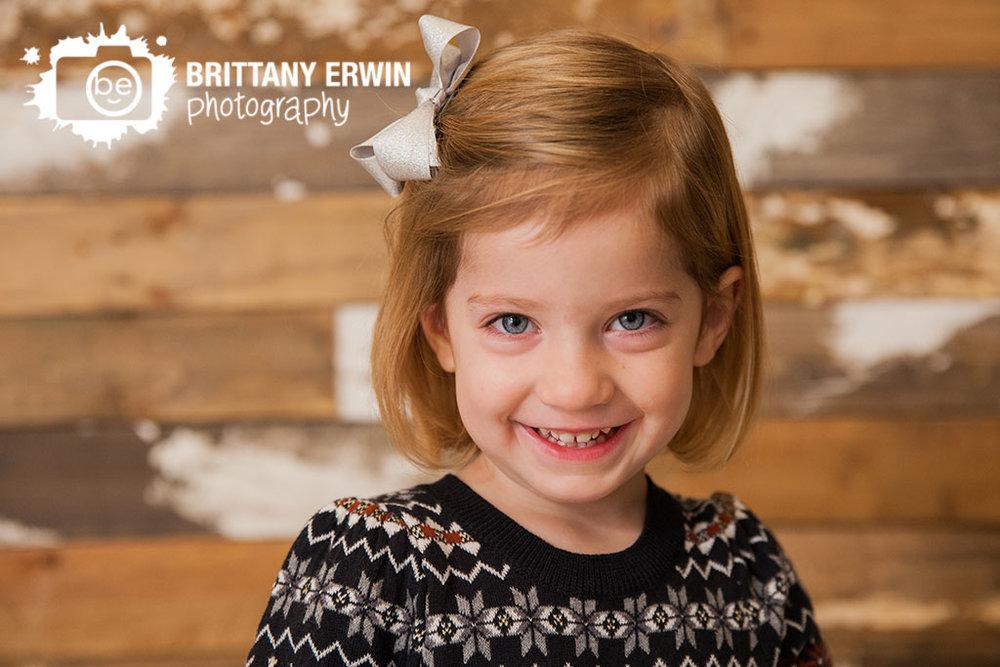 Speedway-Indiana-portrait-studio-photographer-girl-christmas-dress-rustic-barn-wood-wall.jpg