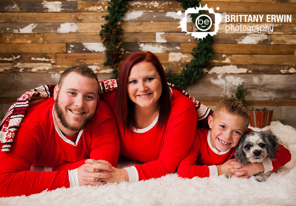 Speedway-christmas-studio-portrait-session-photographer-family-under-blanket-pet-dog.jpg