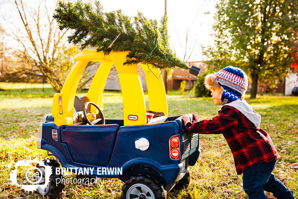Speedway-christmas-card-photographer-toddler-push-toy-truck-tree-tied-to-top.jpg