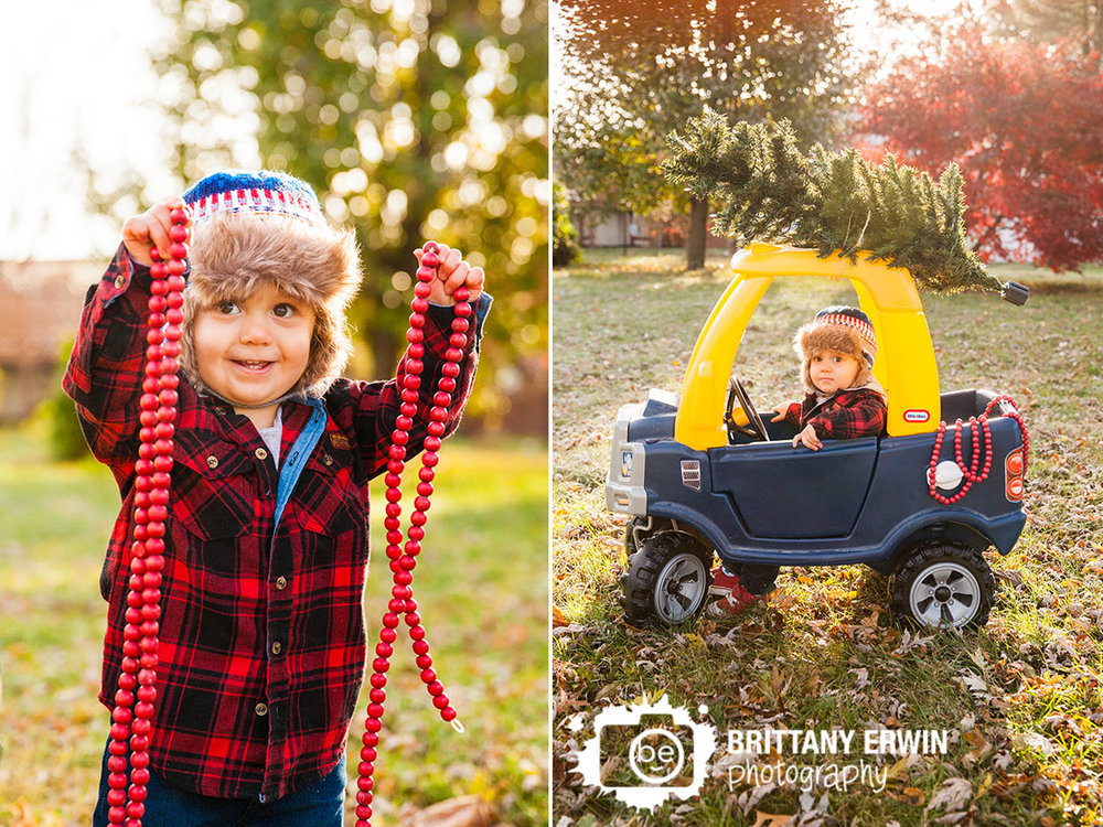 Speedway-Indiana-photographer-baby-boy-plaid-jacket-fuzzy-hat-decoration-tree-on-toy-truck.jpg