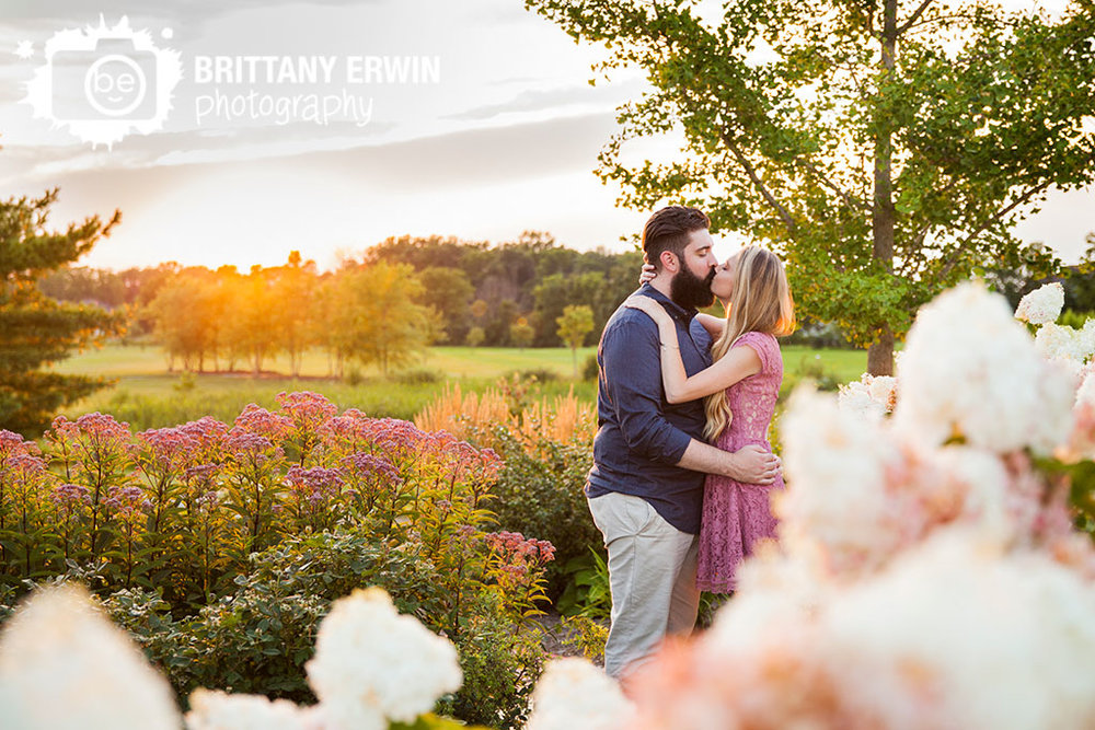 Coxhall-Gardens-Carmel-engagement-portrait-photographer-spring-flower-garden-couple-kiss-sunset.jpg