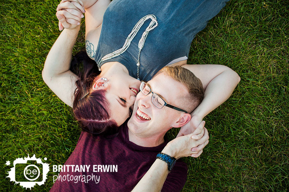 Downtown-Indianapolis-couple-portrait-photographer-engagement-engaged-laughing-in-grass.jpg
