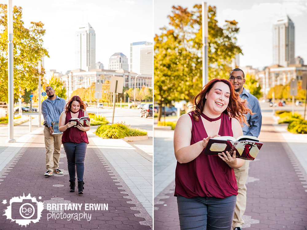Fountain-Square-Indiana-engagement-portrait-photographer-funny-book-stack-couple-walking-downtown-skyline.jpg