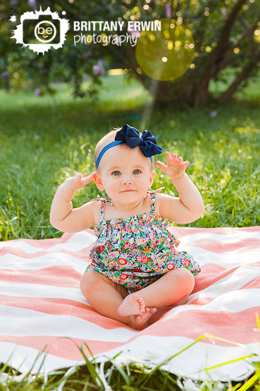 Indianapolis-portrait-photographer-outdoor-picnic-blanket-first-birthday-floral-romper-baby-girl.jpg