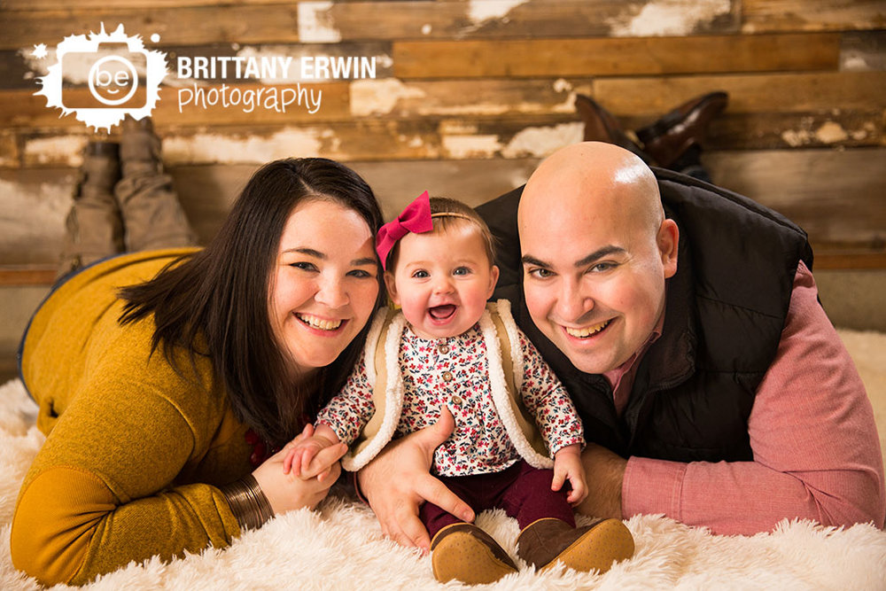 Speedway-studio-portrait-photographer-happy-baby-family-group-rustic-backdrop.jpg