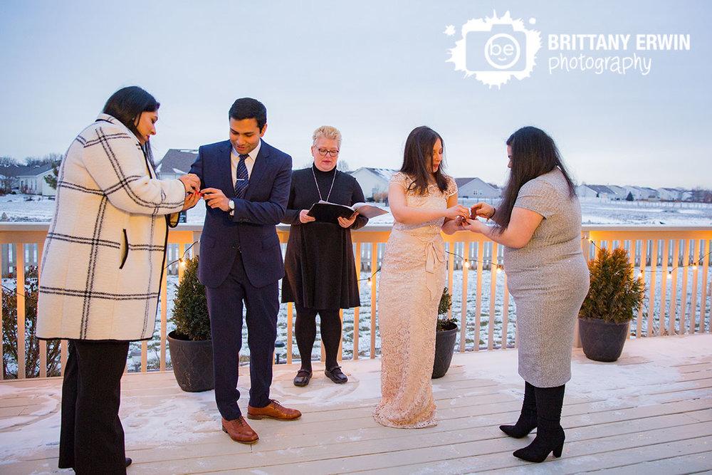 Backyard-elopement-brownsburg-indiana-couple-exchange-rings.jpg