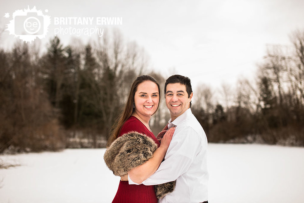 Indianapolis-engagement-portrait-photographer-outdoor-winter-couple-on-dock-near-pond.jpg
