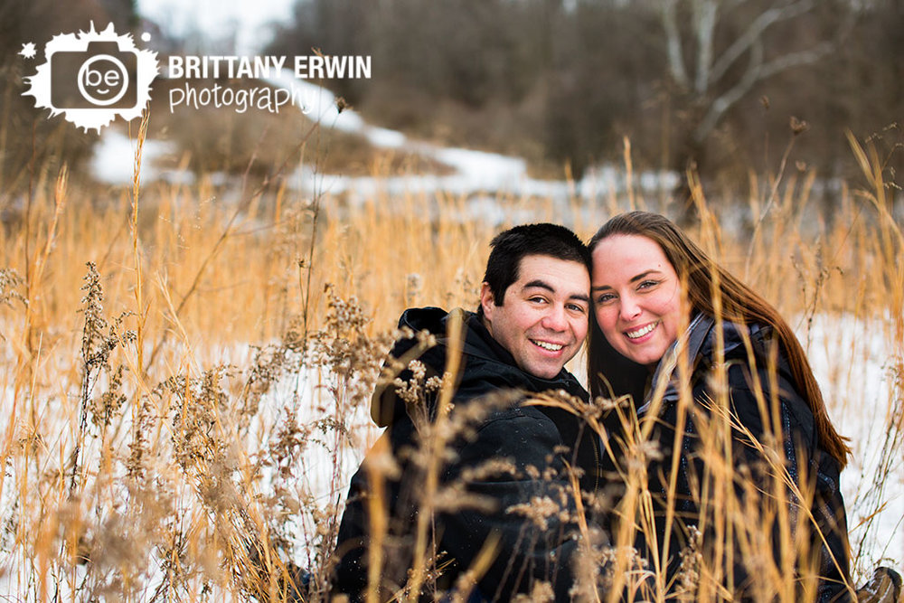 Indianapolis-portrait-photographer-engagement-couple-winter-snow-field-of-grass.jpg