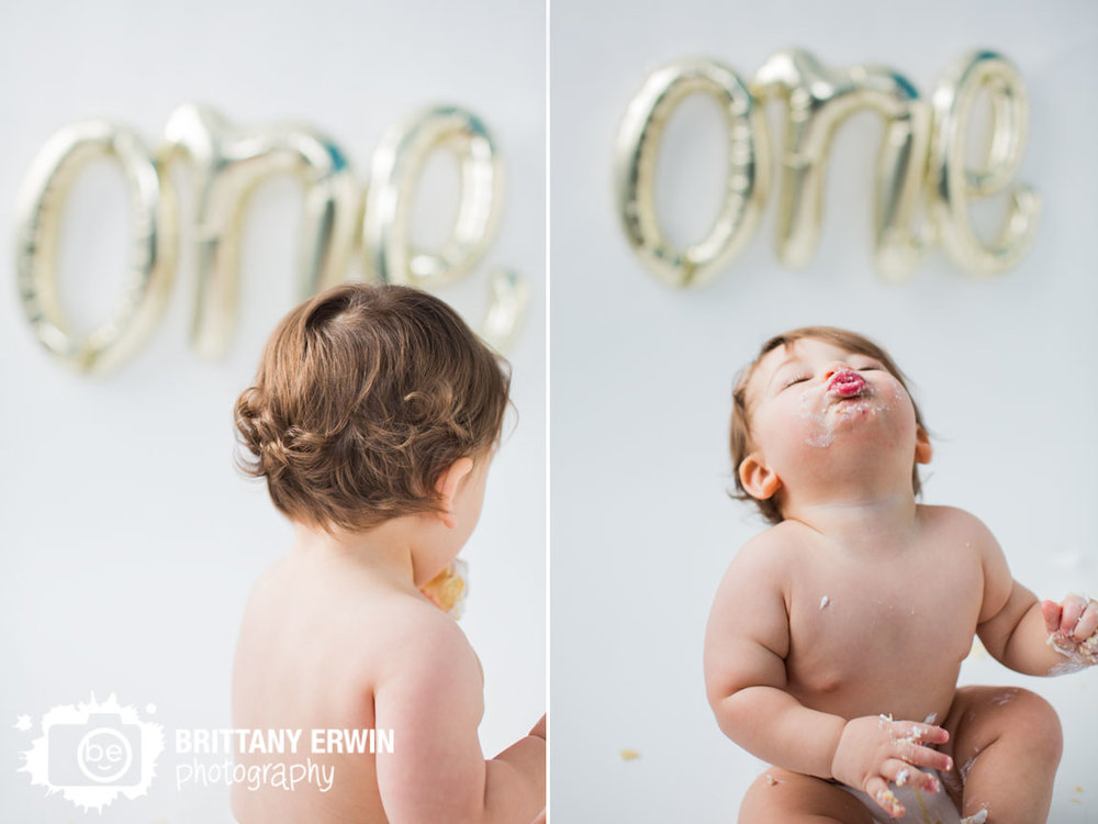 Indianapolis-portrait-studio-photographer-cake-smash-first-birthday-baby-boy-silly-face-one-balloon.jpg