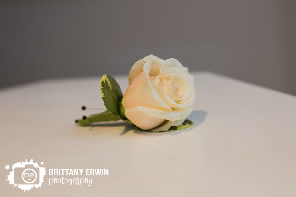 Indianapolis-wedding-photographer-winter-boutonniere-white-rose-flower-ricks-cafe-boatyard.jpg