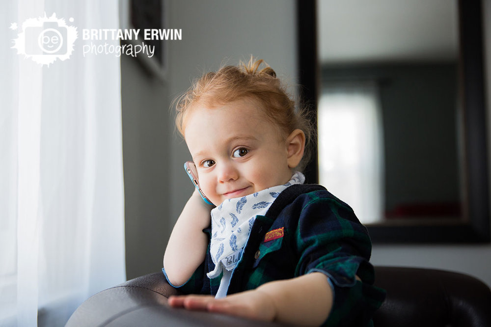 Indianapolis-lifestyle-photographer-hipster-toddler-boy-man-bun-on-cell-phone.jpg