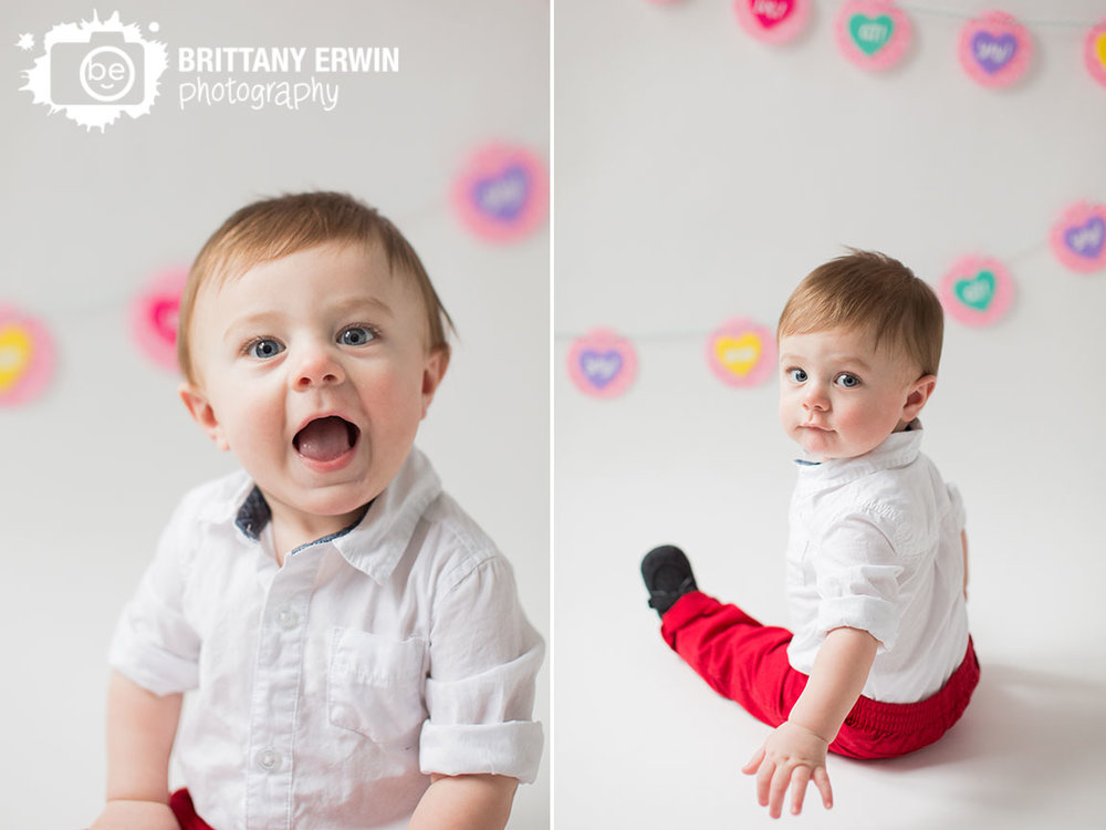 Indianapolis-baby-boy-valentines-day-portrait-photographer-conversation-heart-banner-red-pants.jpg