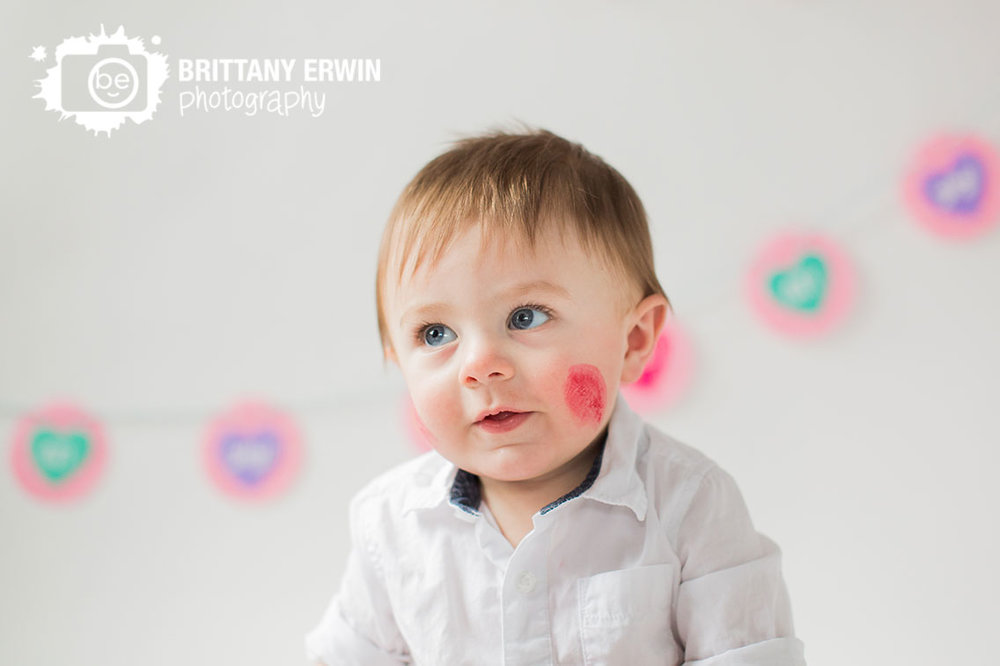 Indianapolis-valentines-day-baby-boy-portrait-lipstick-cheek-kiss-portrait-photographer-white-backdrop.jpg