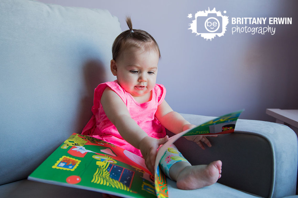 Indianapolis-lifestyle-portrait-photographer-baby-girl-reading-book-in-rocking-chair.jpg