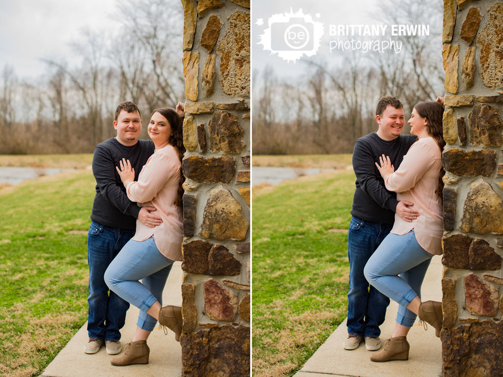 Indianapolis-engagement-outdoor-spring-photographer-couple-on-stone-wall-laugh-fun.jpg