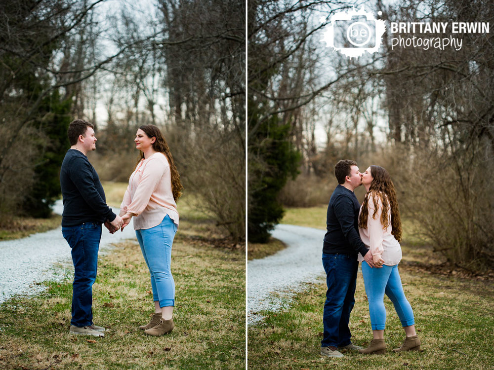 Indianapolis-engagement-portrait-photographer-couple-by-path-kiss-outdoor-spring.jpg