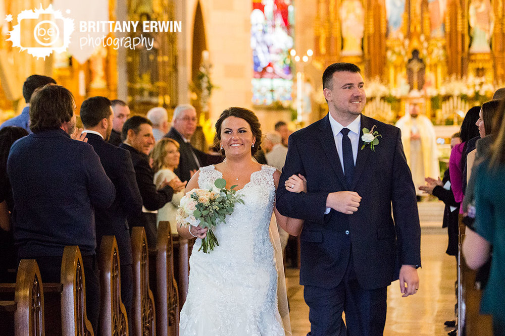 Indianapolis-sacred-heart-catholic-church-couple-walk-down-aisle-ceremony.jpg