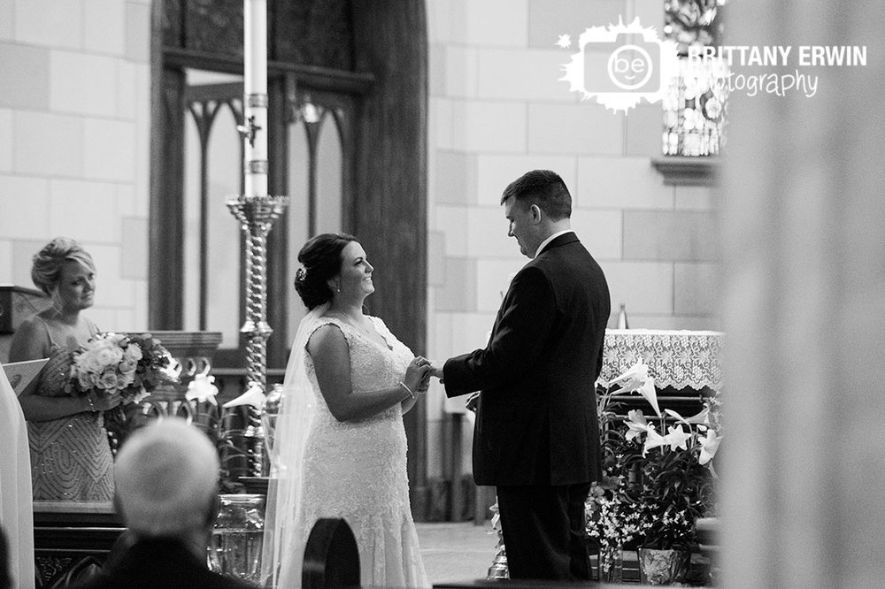 Indianapolis-wedding-photographer-ceremony-sacred-heart-catholic-church-exchange-rings.jpg