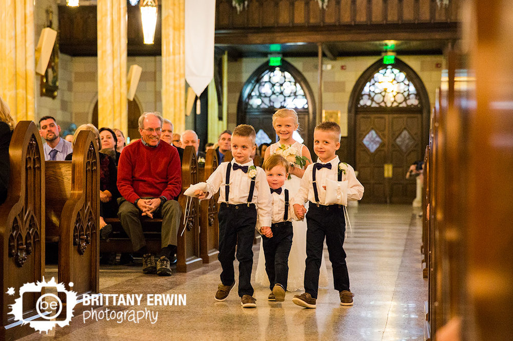 Indianapolis-wedding-photographer-ring-bearers-hold-hands-down-aisle-sacred-heart-catholic-church.jpg