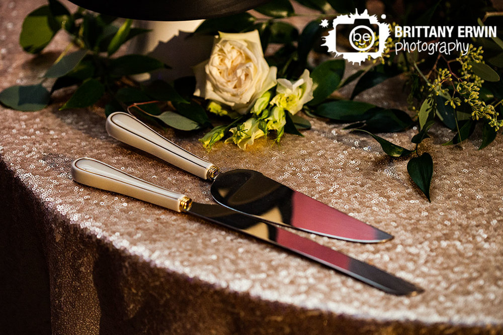 Indianapolis-wedding-reception-photographer-gold-sequin-table-cloth-cake-table-cutting-serving-knife-flowers.jpg