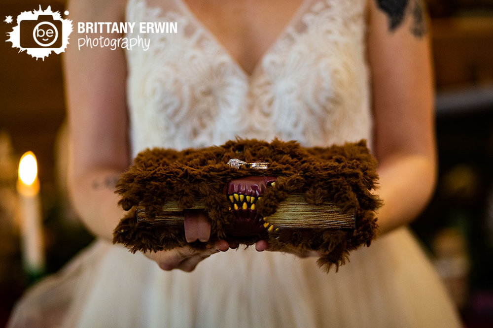 3-Fat-Labs-nerdy-fox-rentals-wedding-photographer-ring-book-monster-teeth-rings-detail.jpg