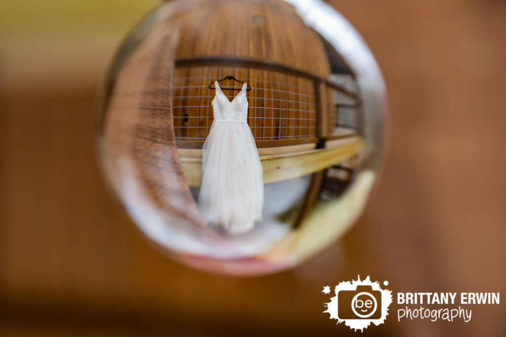 Greencastle-Indiana-wedding-dress-hanging-from-railing-3-fat-labs-barn-event-venue.jpg