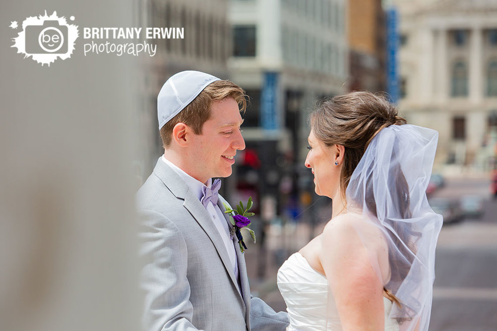 Downtown-Indianapolis-first-look-wedding-photographer-couple-on-monument-circle-purple-boutonniere.jpg