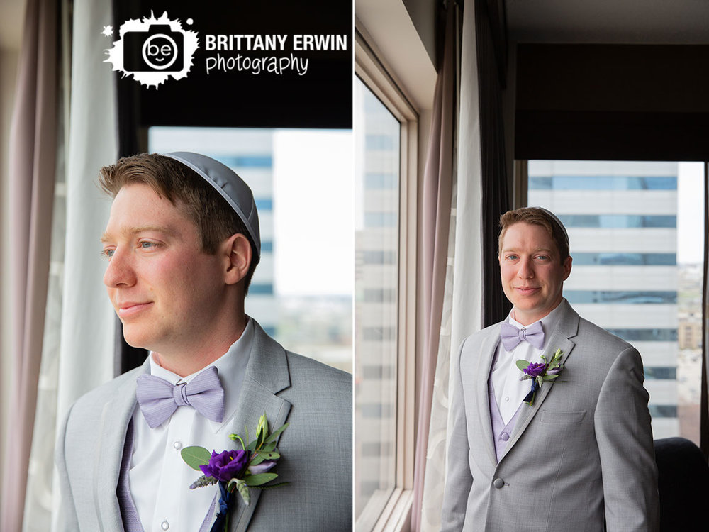 Downtown-Indianapolis-hotel-sheraton-Jewish-wedding-photographer-groom-getting-ready-window-portrait-violets-are-blue-boutonniere.jpg