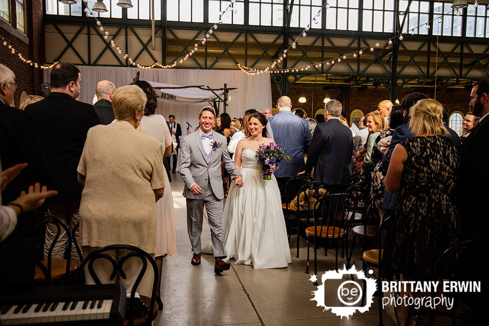Downtown-Indianapolis-wedding-ceremony-photography-couple-walk-down-aisle-clapping.jpg
