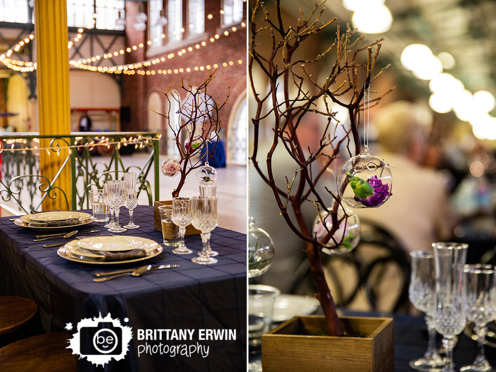 Downtown-Indianapolis-wedding-reception-photographer-sweetheart-table-glasses-tree-centerpiece-hanging-globe-flowers.jpg
