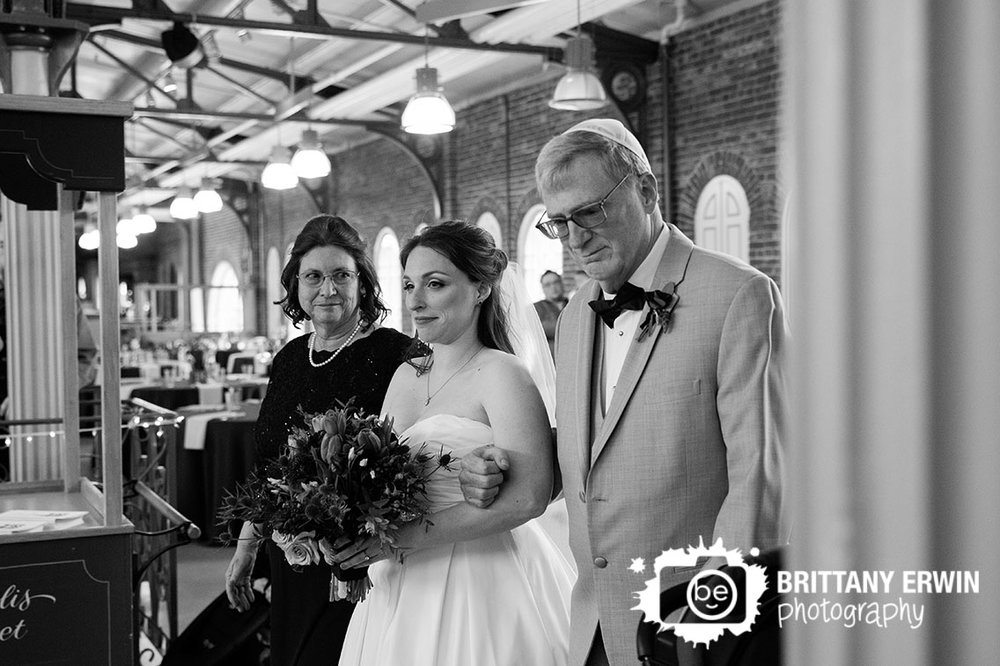 Downtown-Indianapolis-city-market-jewish-wedding-ceremony-photographer-bride-walking-down-aisle-with-parents.jpg