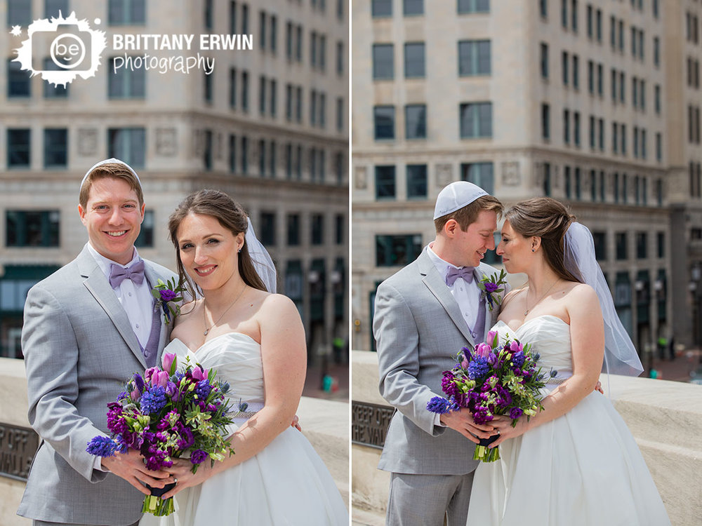Downtown-Indianapolis-couple-first-look-on-monument-circle-violets-are-blue-indy-bouquet-hand-made-veil.jpg