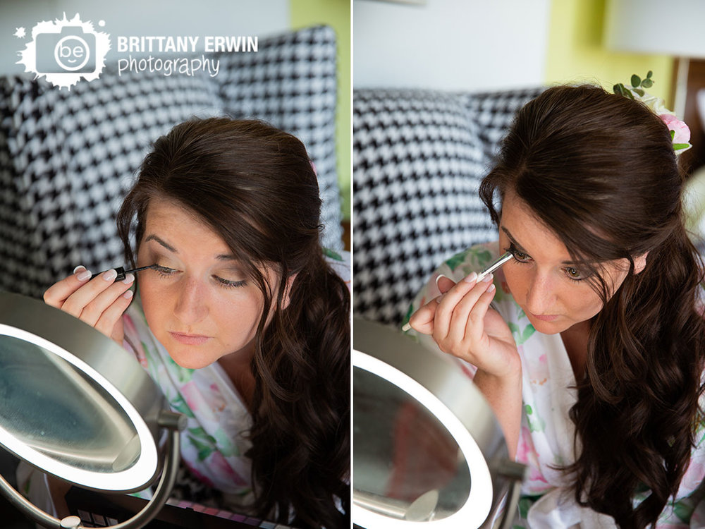 Columbus-Indiana-bride-doing-her-own-makeup-in-lighted-mirror-hotel-indigo.jpg